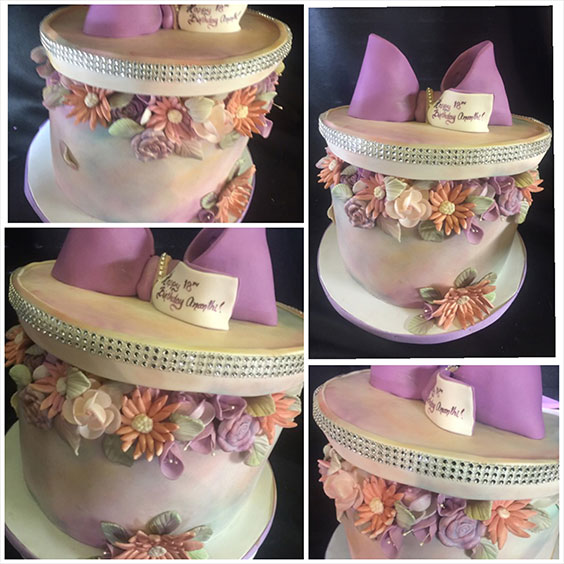 Lavender Colored Cake with Flowers and a Bow